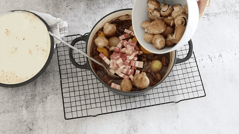adding the speck and mushrooms to Cheats Rich Beef Bourguignon - Beef Mushroom and Red Wine Casserole