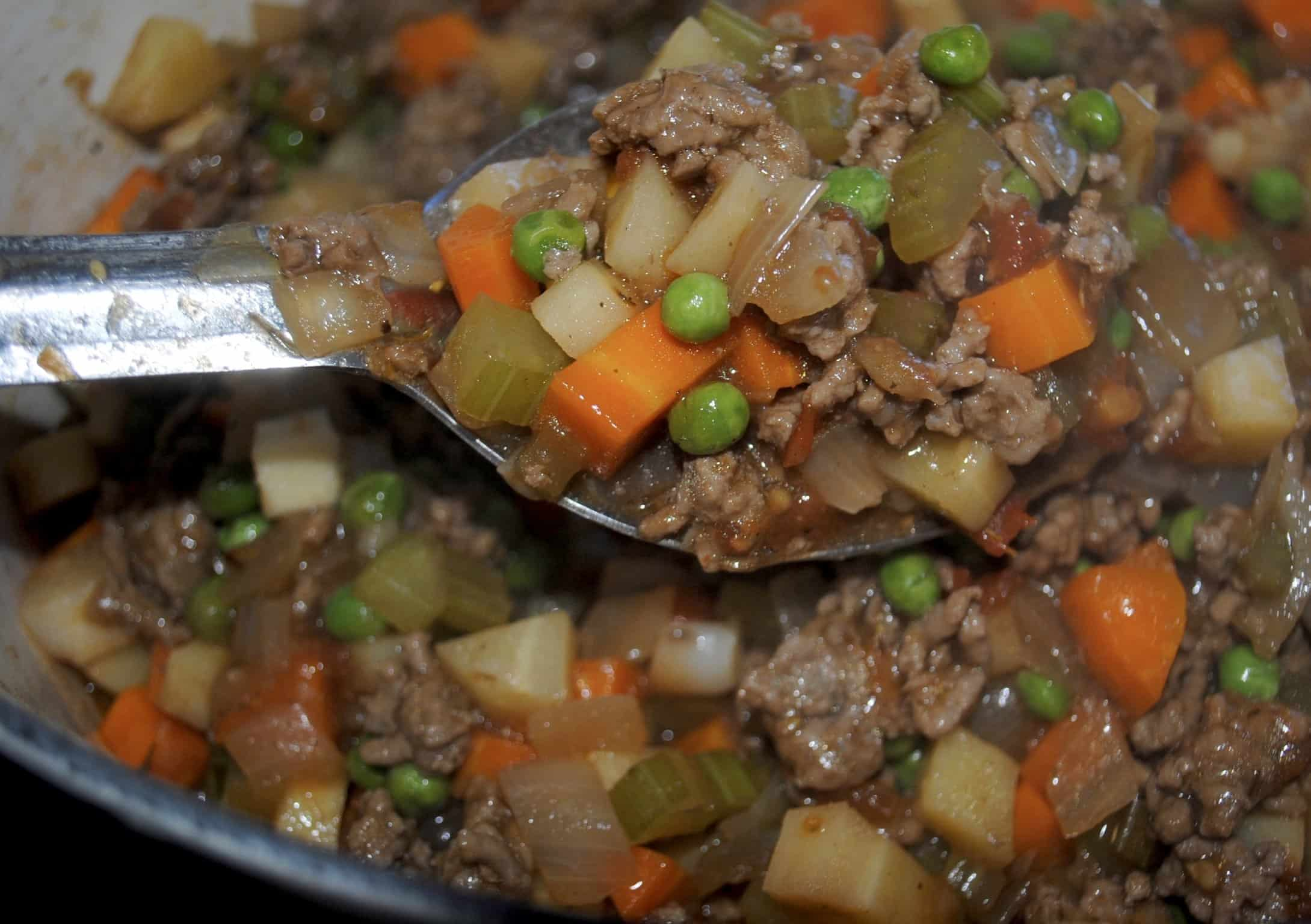 shepherds pie - mixture thickened and displayed on a silver spoon
