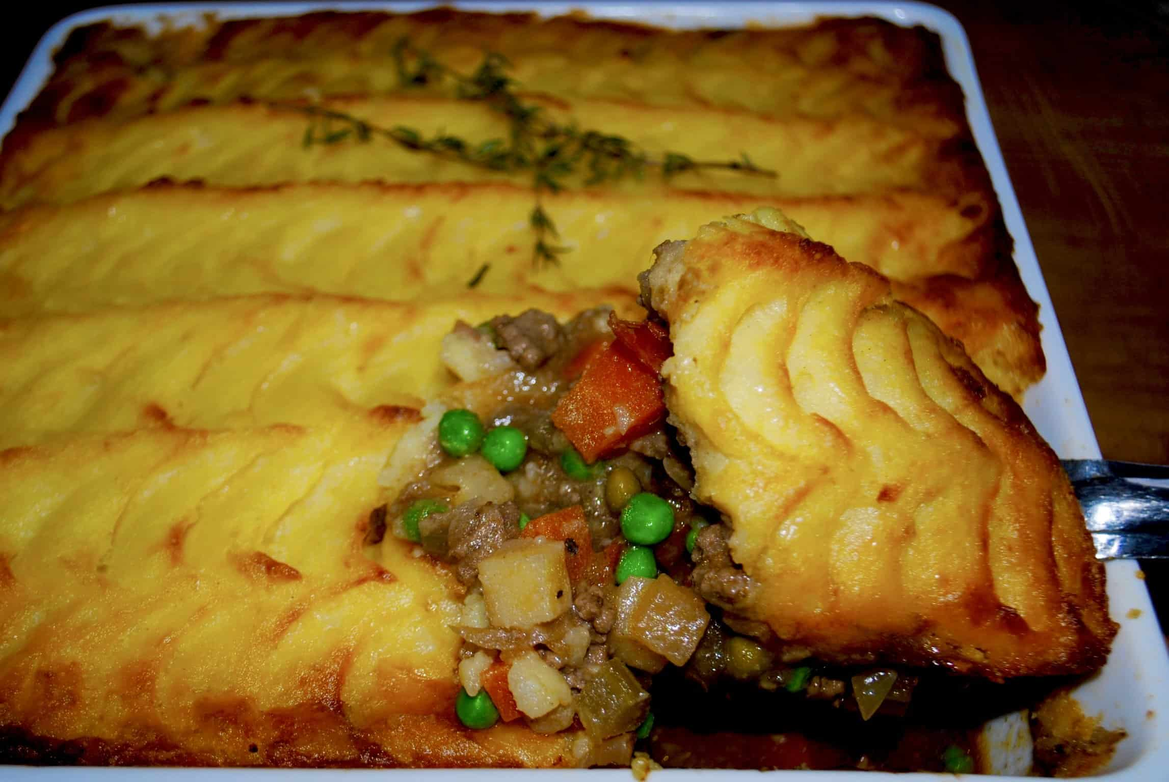 shepherds pie - with a large serve of pie on metal spoon