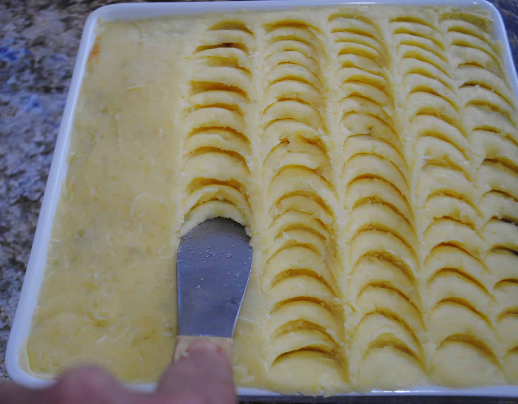 Shepherds pie - decorating the potatoes with the end of a palette knife