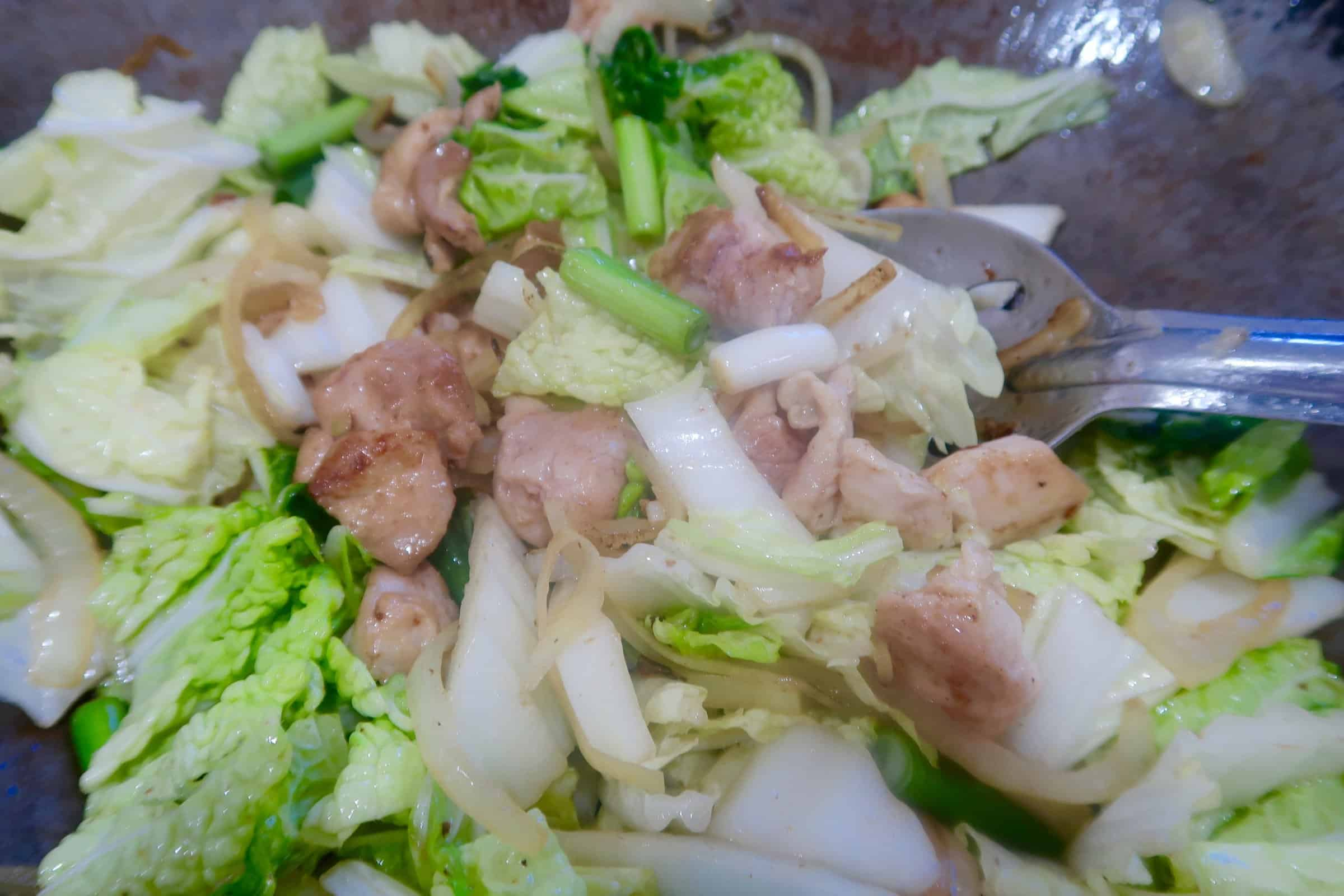 chicken yakisoba onions, chicken stir fried and adding womb and shallots