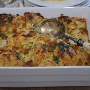 cauliflower with blue cheese gratin baked with spoon ready to serve