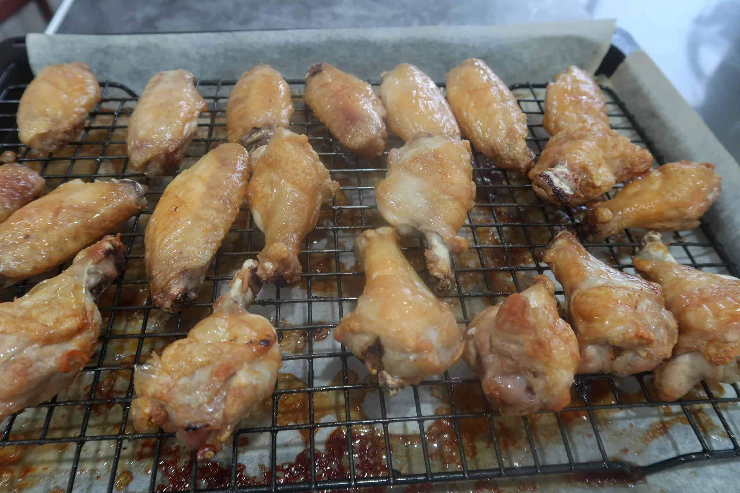 oven baked chicken wings with ginger garlic dressing cooked wings on cake rack