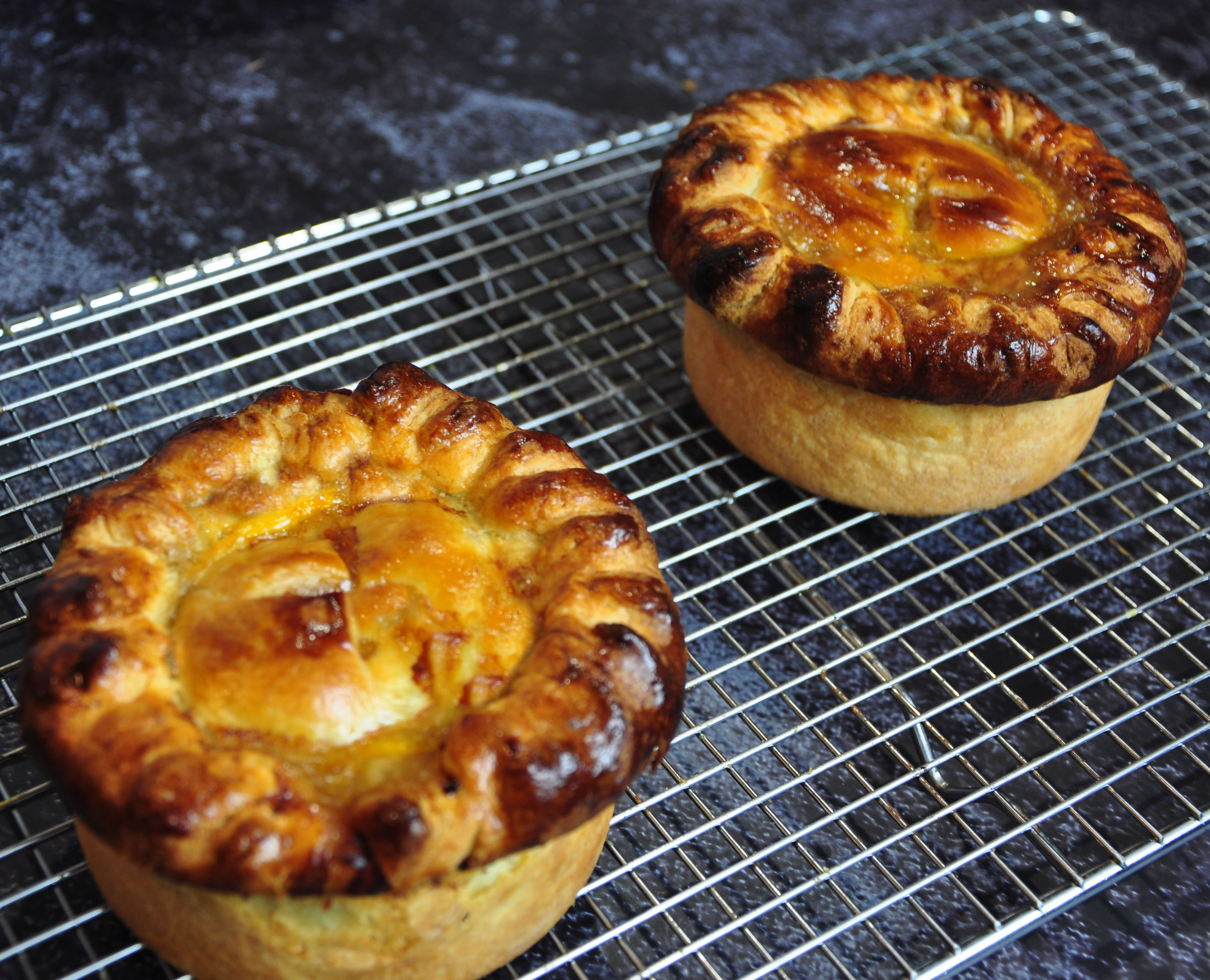 Bouef b pies fresh from the oven on a cake cooling rack