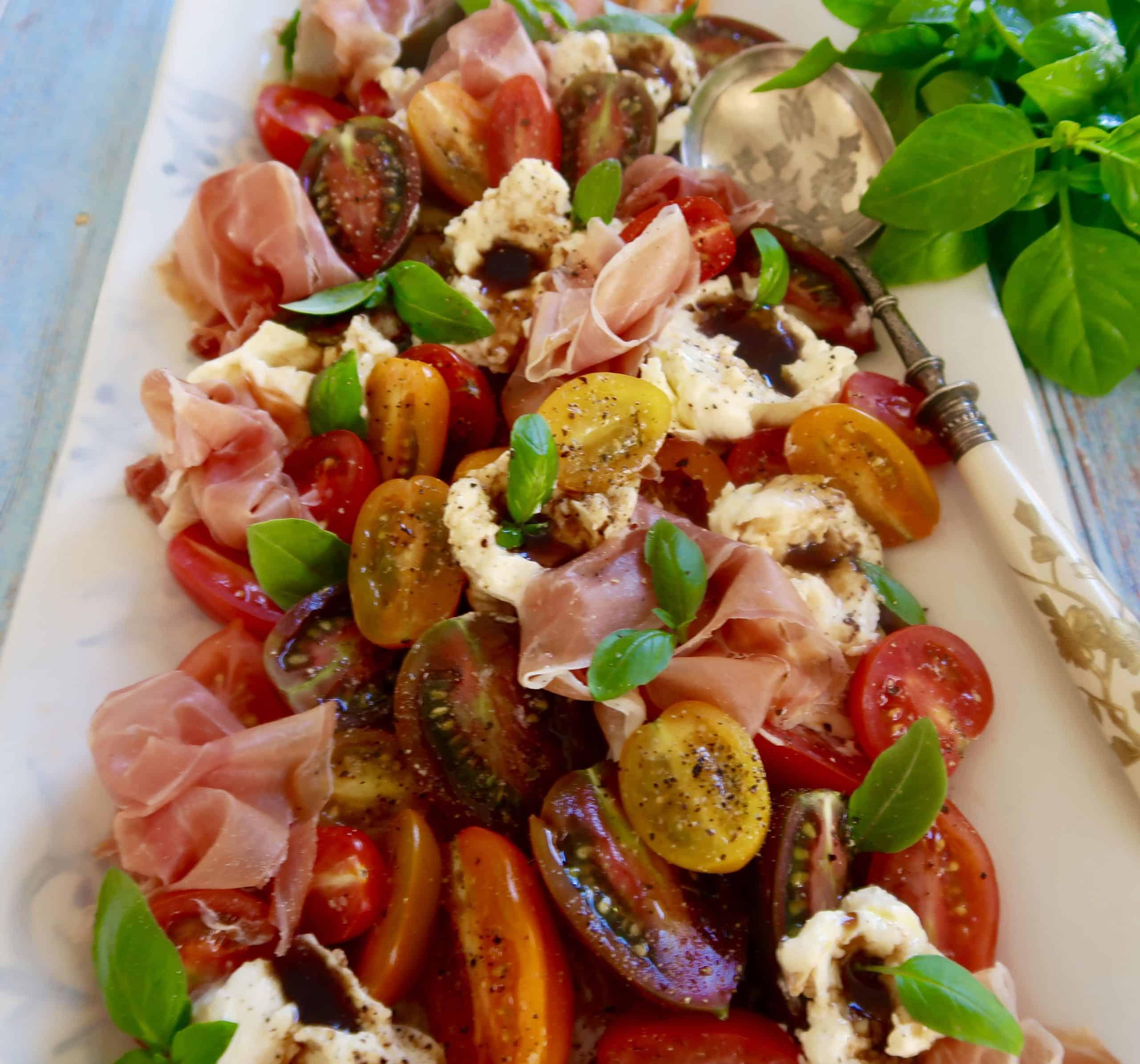 tomato, burrata, basil and prosciutto salad