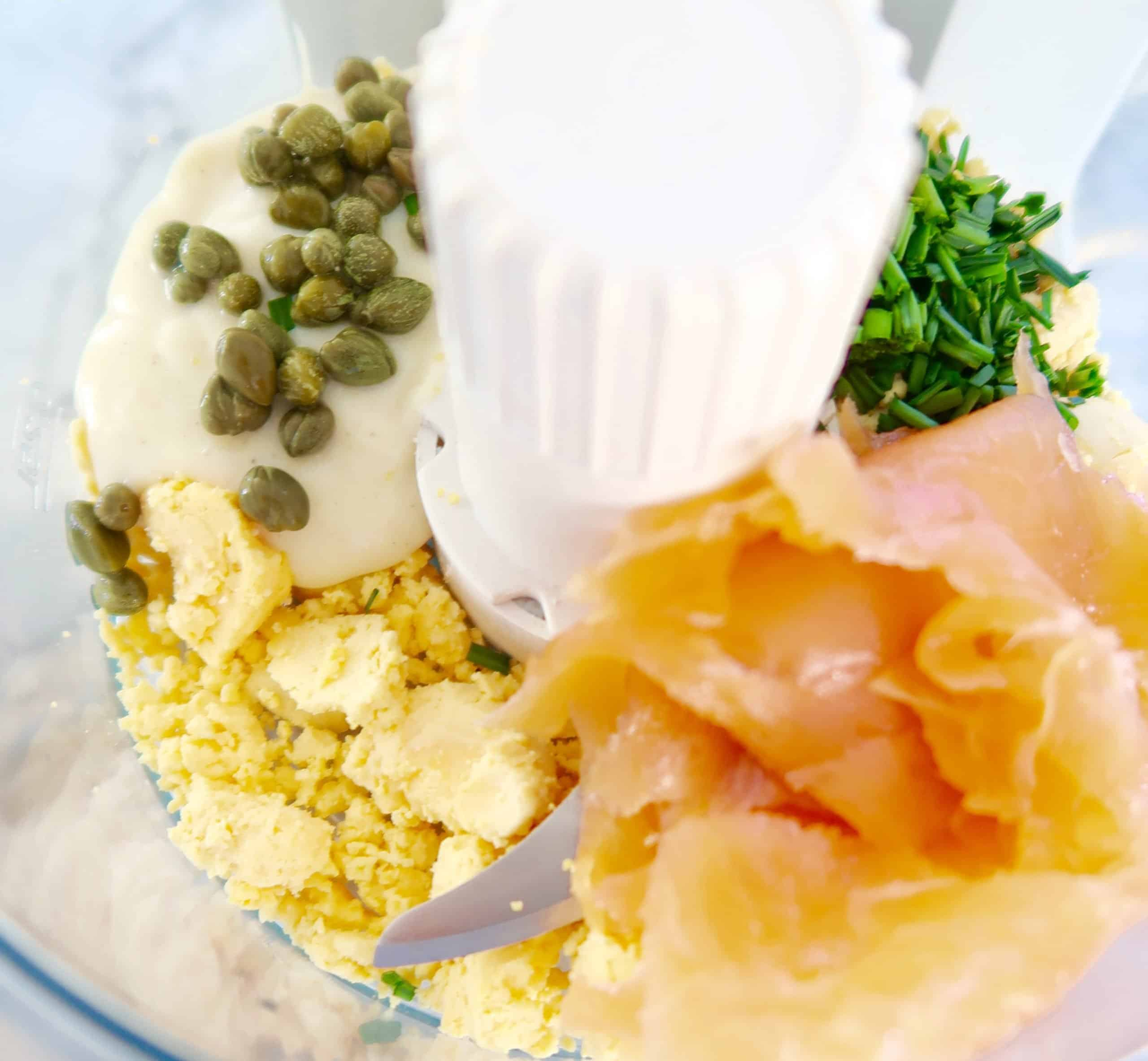 devilled eggs with smoked salmon yolks, smoked salmon, capers, salmon and chives added to food processor