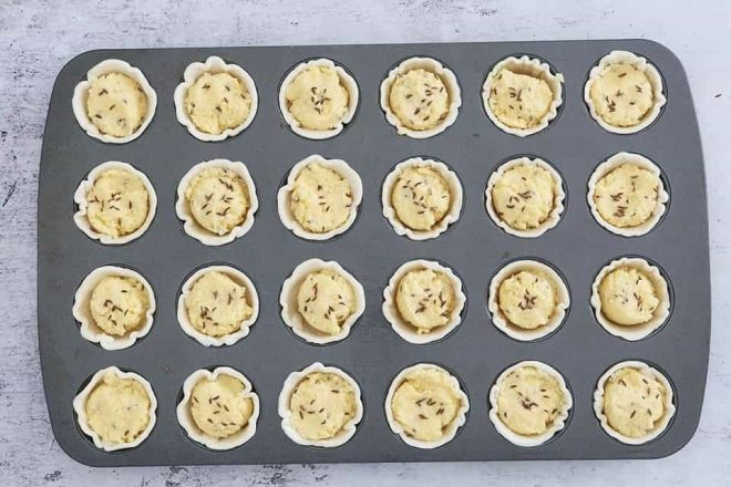 unbaked Easy Cheese Puff Tarts in a mini muffin tin