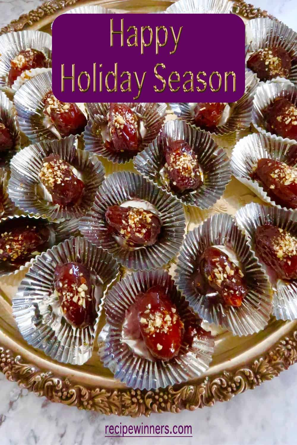 Chocolate and almond toffeed dates served on a silver tray make the perfect finish to the holiday season finger food list