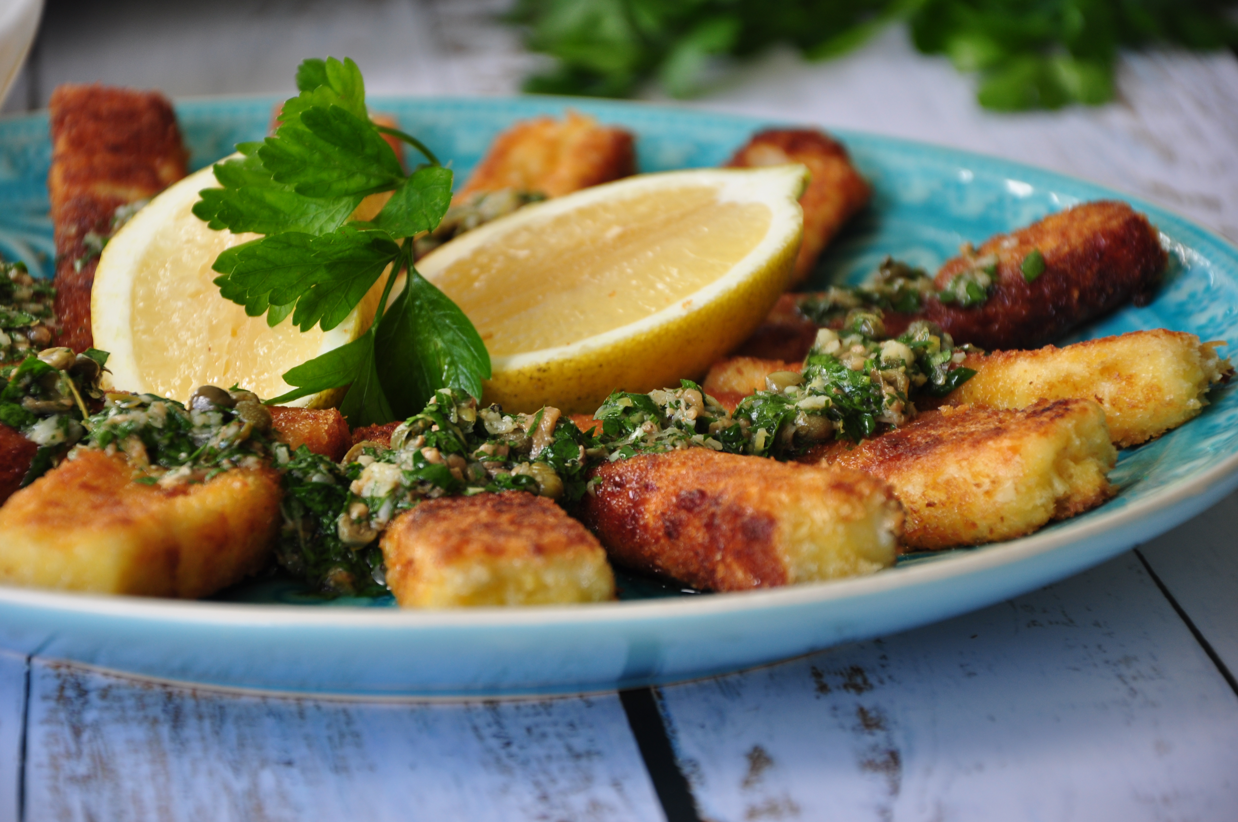 Haloumi fries with roasted garlic, anchovy and caper sauce are a terrific holiday season finger food