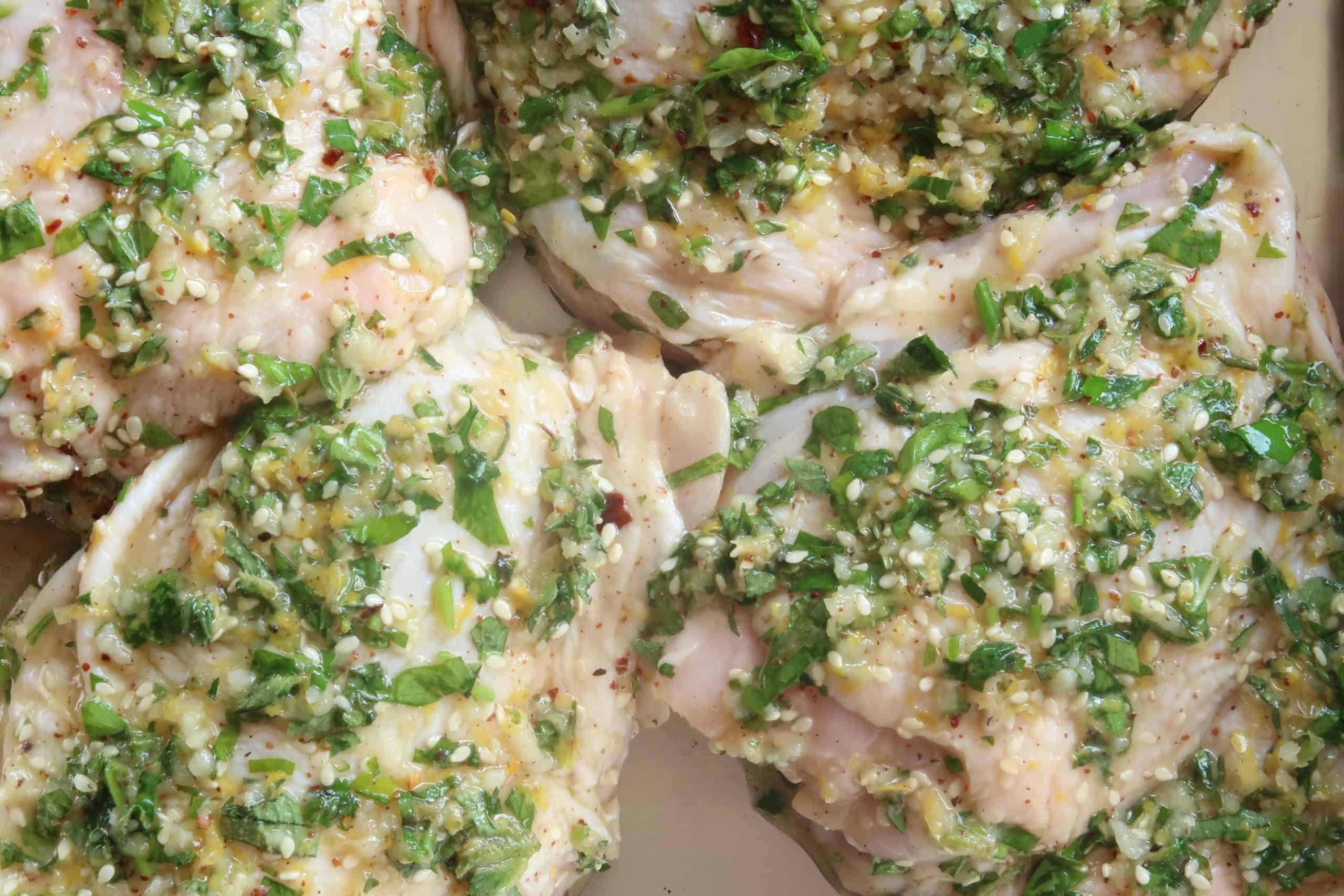 chicken thighs with marinade applied for Middle Eastern Herb and Garlic Chicken Thighs