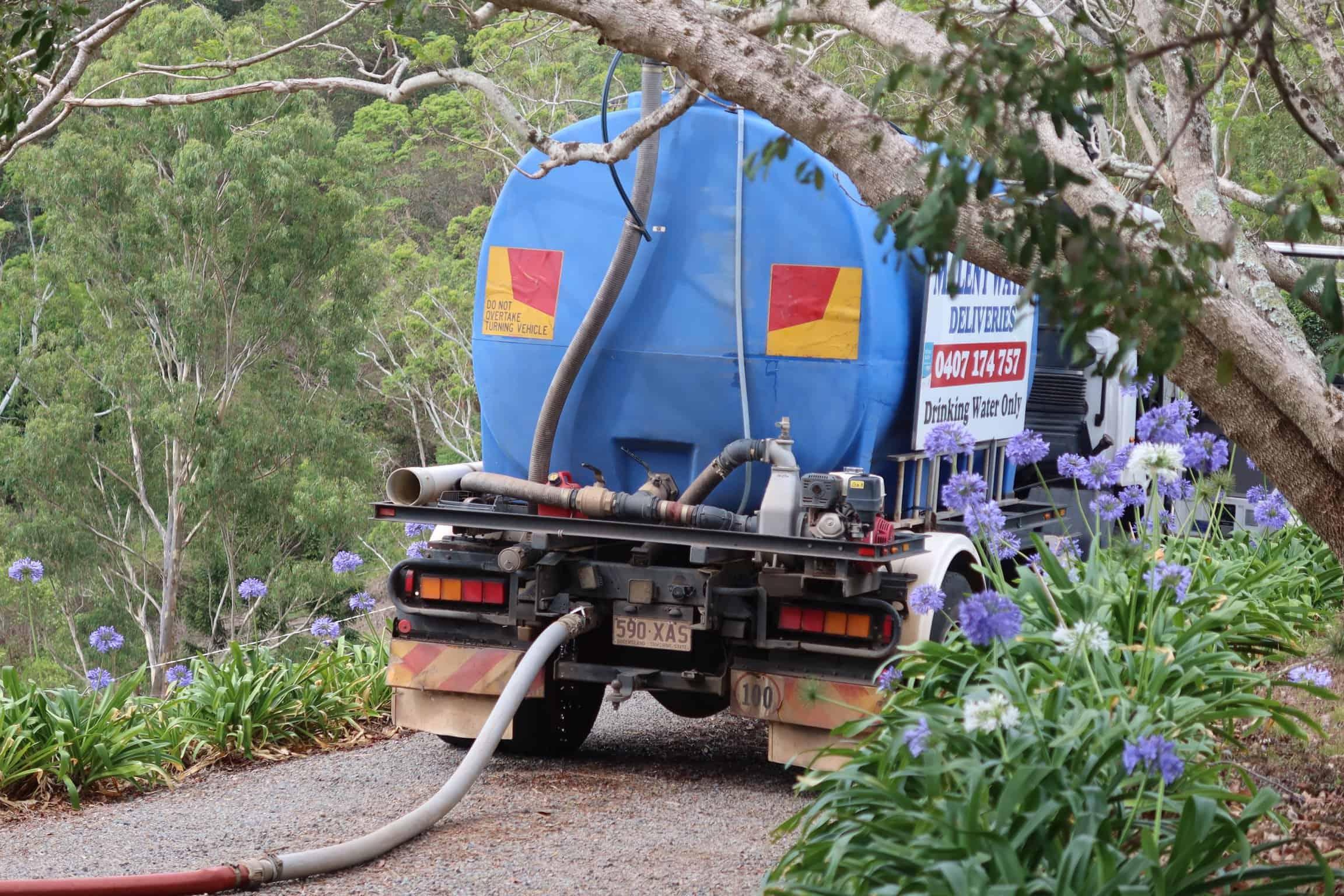 authentic thai beef salad water truck in the driveway with hose