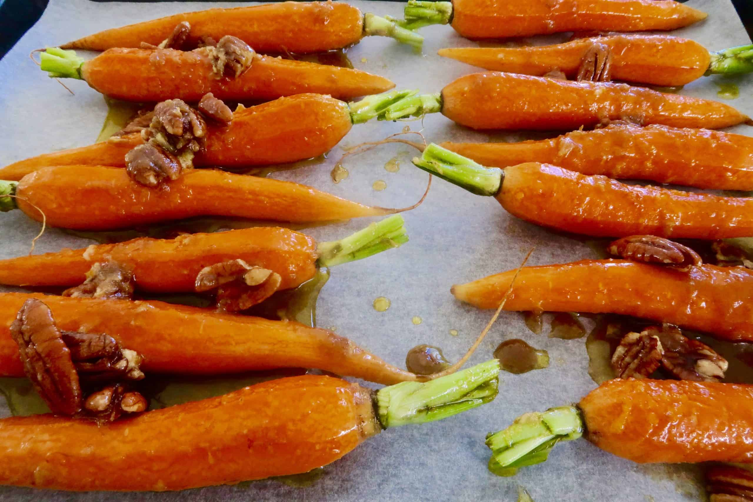 brown sugar and ginger glazed carrots on a baking sheet