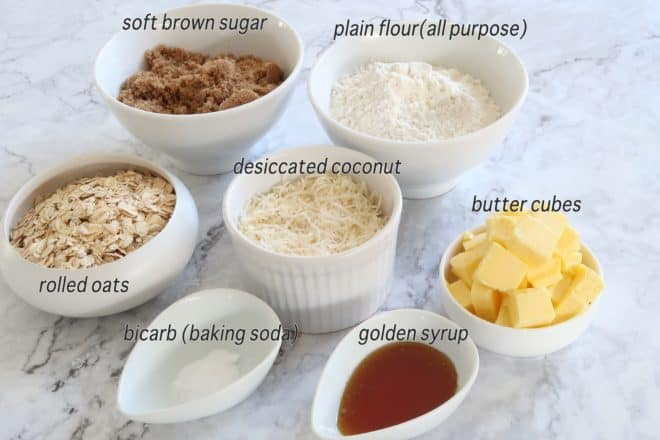 Anzac biscuits ingredients laid out on a marble bench ready to prepare