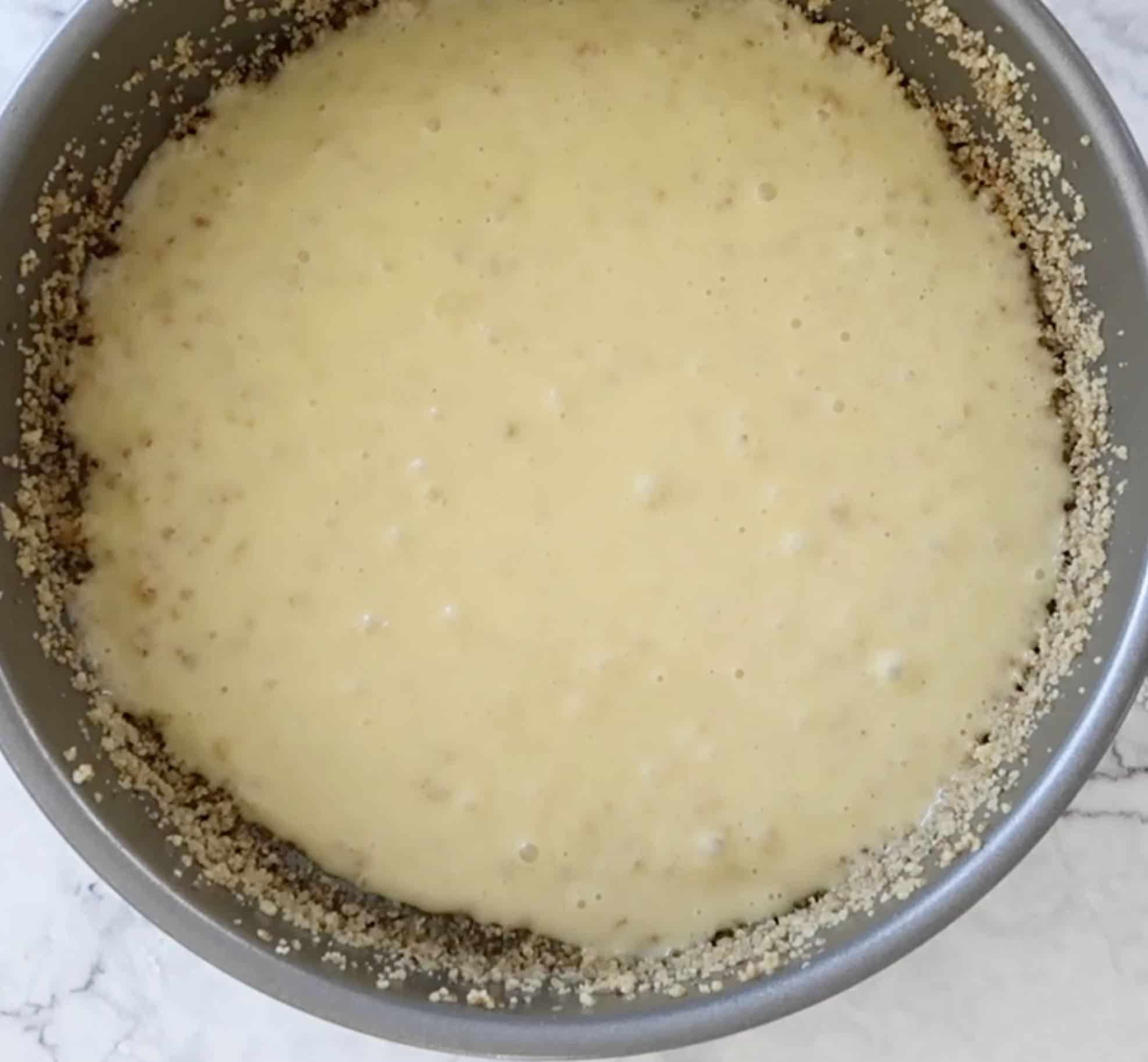 cake batter in bottom of pan ready to assemble the Sicilian Apple Cake