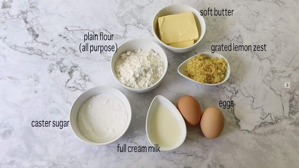 ingredients for lemon lava cakes on a marble table