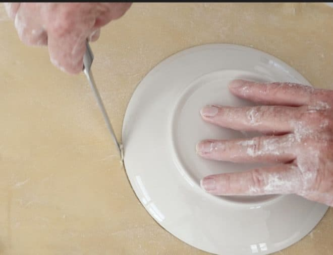 cutting pastry to make chicken, leek and mushroom pie