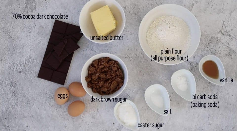 chocolate chip crinkle cookies ingredients on a marble bench ready to prepare