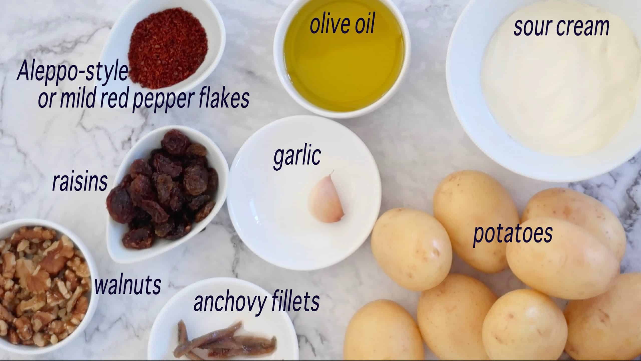 crispy smashed potatoes with walnut chilli dressing ingredients ready to prepare