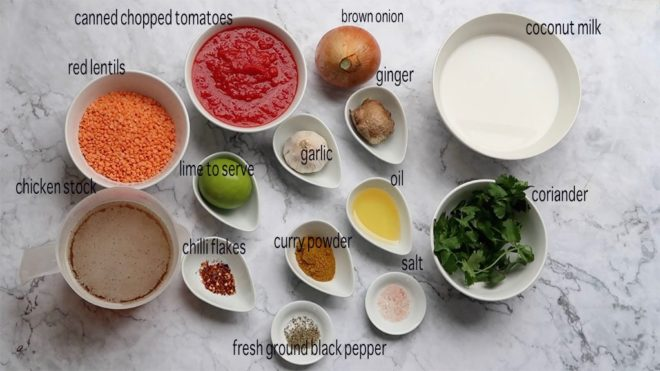 curried lentil, tomato and coconut soup ingredients in dishes ready to prepare