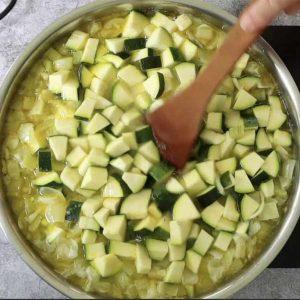 zucchini added to soup pot to make Zucchini soup with pesto
