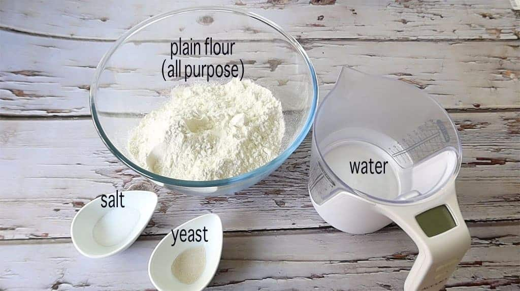 ingredients for no knead pizza on a marble table
