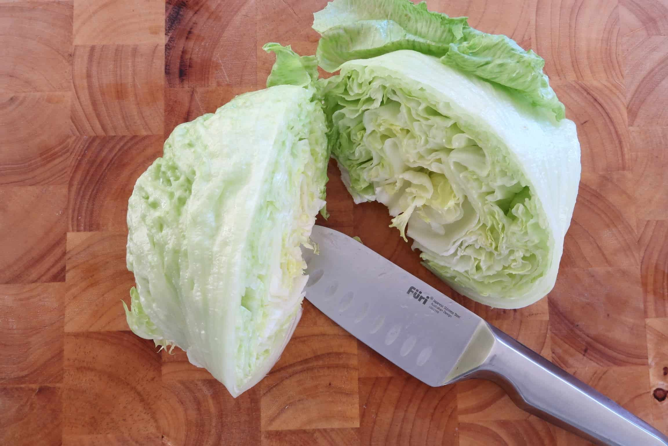 San Chow Bow lettuce cut in half, washed and separated in to cut to serve the San Chow Bow in
