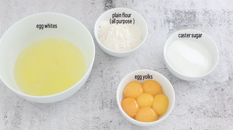 ingredients for Lemon Roulade on a concrete table
