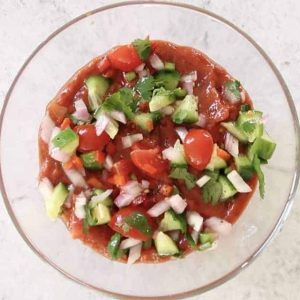 pico de gallo in a glass bowl to make Mexican Layered Dip