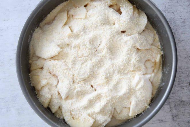 fresh apple crumble cake sliced apples sprinkled onto shortbread base