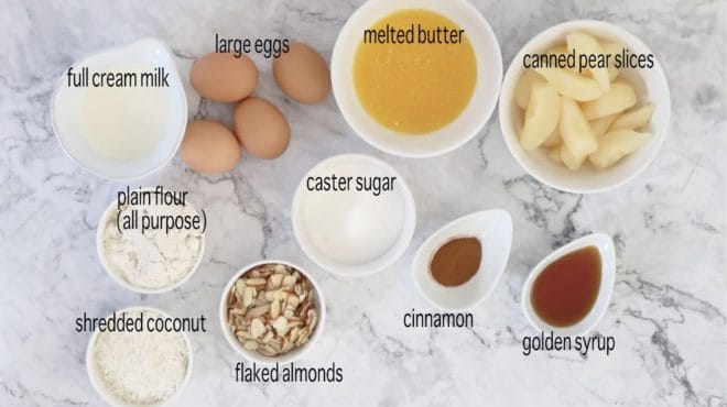 ingredients for pear and almond impossible pie on a marble table