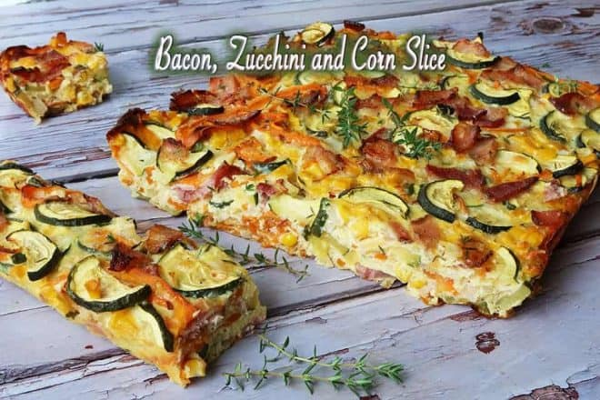 Bacon, Zucchini and Corn Slice on a blue timber board
