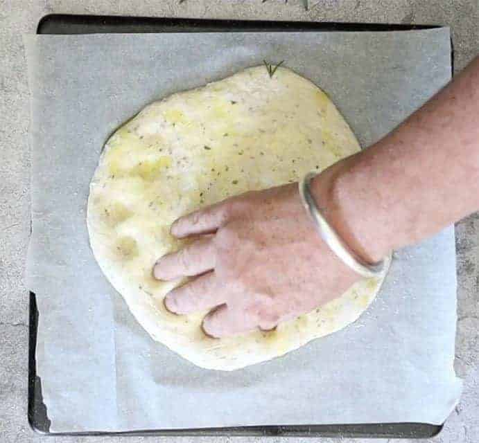 press dimples into the Tomato, Olive and Garlic Focaccia