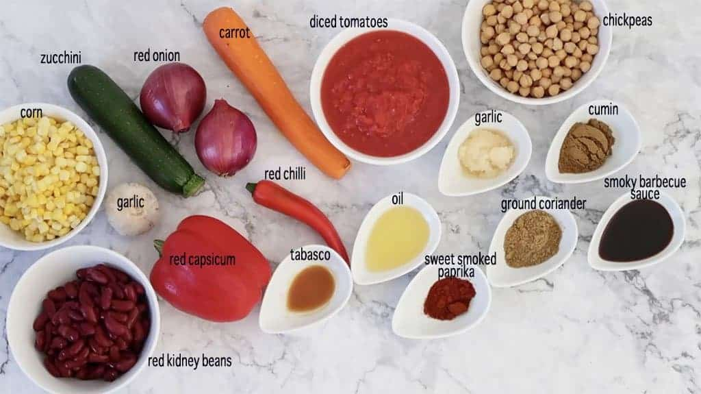 vegetable chilli ingredients laid out on a marble bench