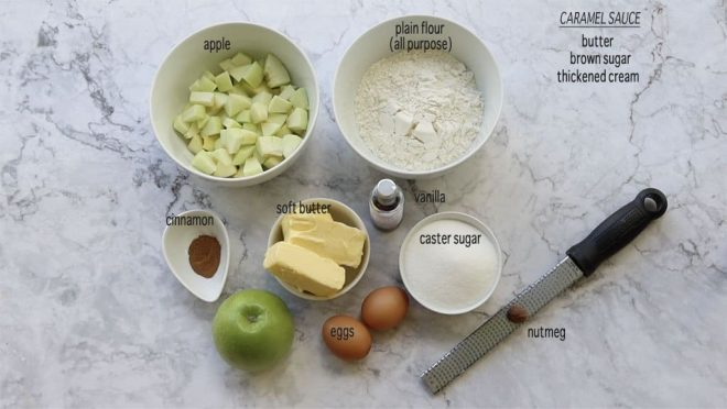 ingredients for Caramel Apple Poke Cake on a marble table