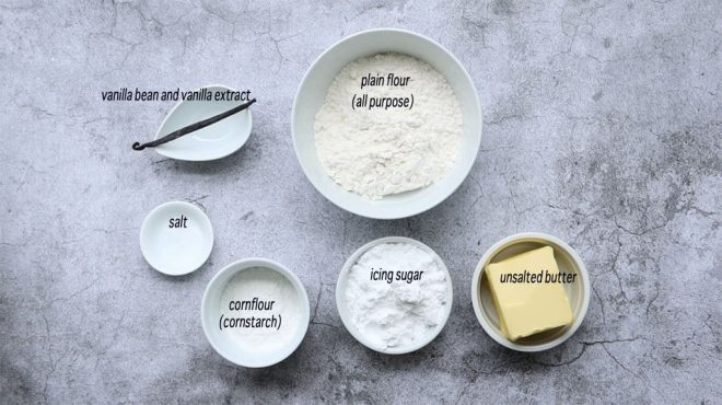 ingredients for Vanilla Bean Shortbread on a concrete table