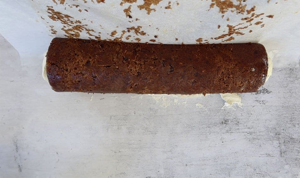 removing baking paper from a cream filled sticky date roll