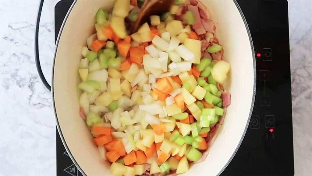 vegetables sautéing in a pot with butter