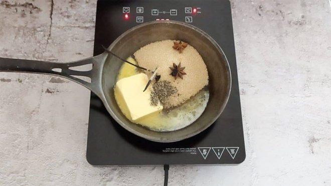 Ingredients to make the caramel for Apple Tarte Tatin in a black frying pan