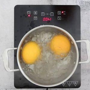 simmering oranges to make Flourless Chocolate and Orange Cake