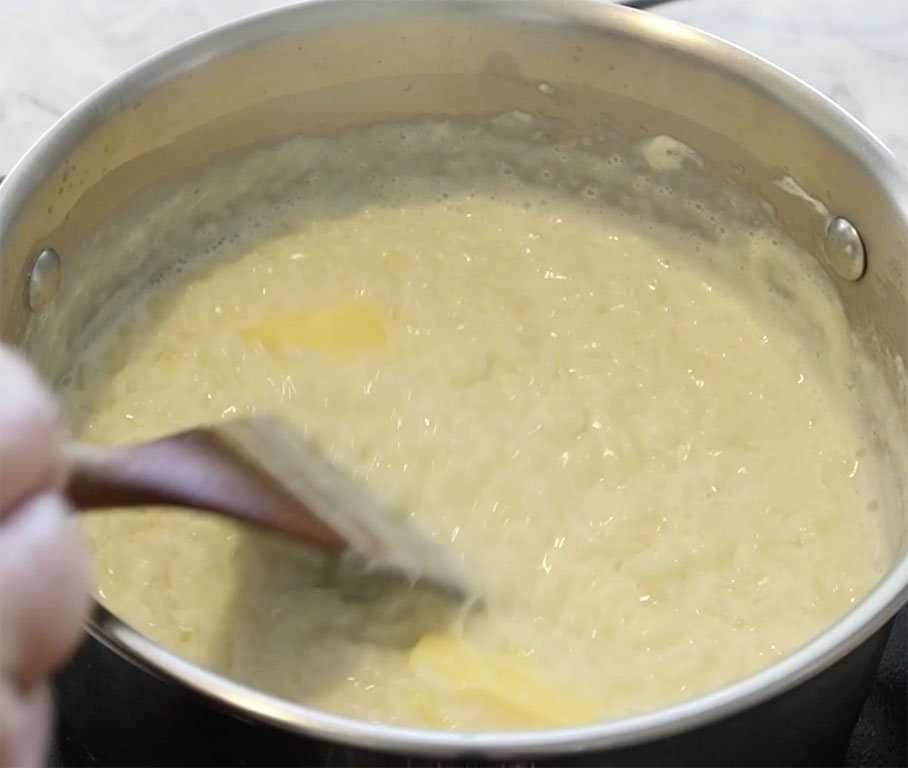 pot removed from heat and butter added for Creamy Vanilla Rice Custard