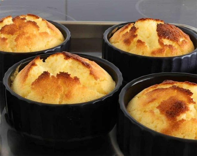 Upside Down Lemon Delicious puddings baked in a black ramekin