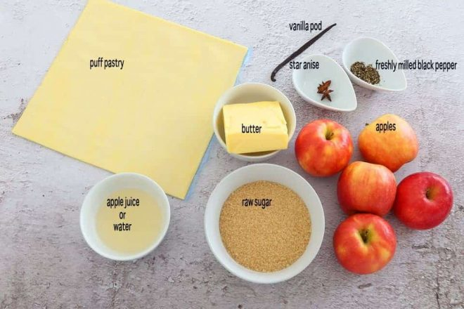 ingredients to make Apple Tarte Tatin with Star Anise and Black Pepper on a concrete table