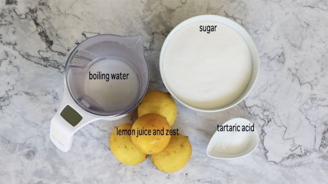 homemade lemon cordial ingredients on a marble bench ready to prepare