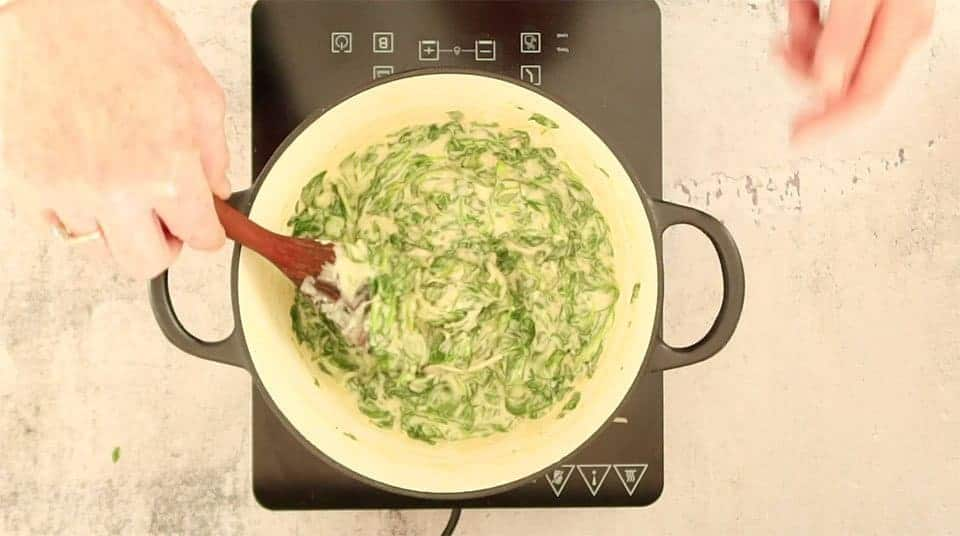 Steakhouse Creamed Spinach cooked in a saucepan