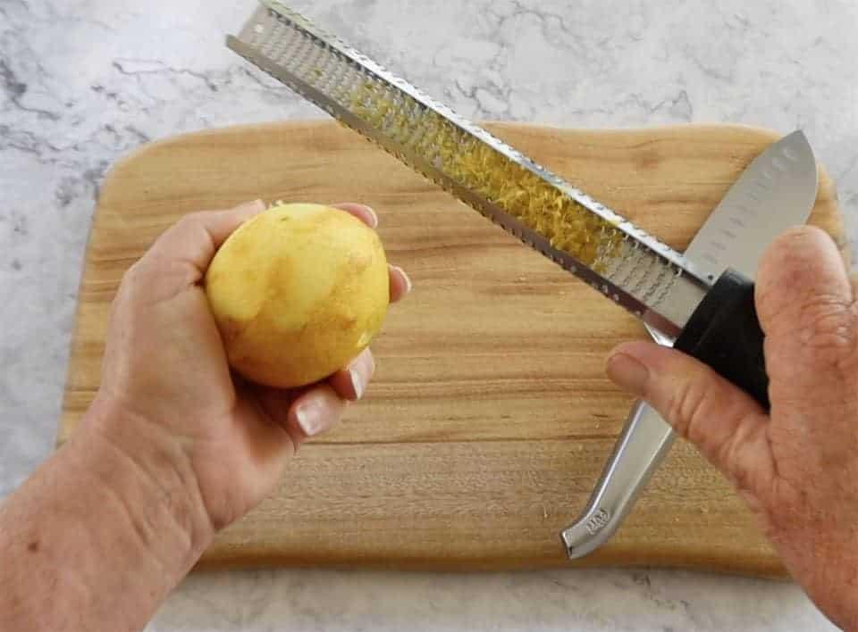 homemade lemon cordial grating lemon rind with a microplane