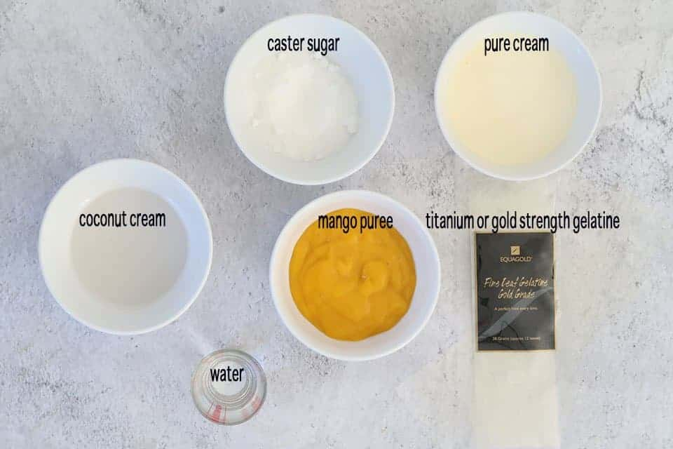 ingredients to make Mango Mousse with Passionfruit on a concrete table
