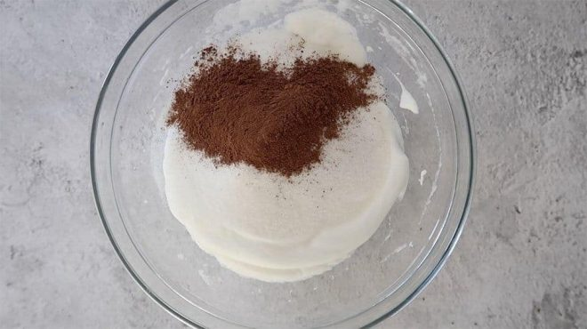 adding the sugar and cocoa powder to the Simple Meringue Kisses mixture