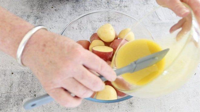 dressing potatoes on a glass bowl to make No-Mayo Potato Salad