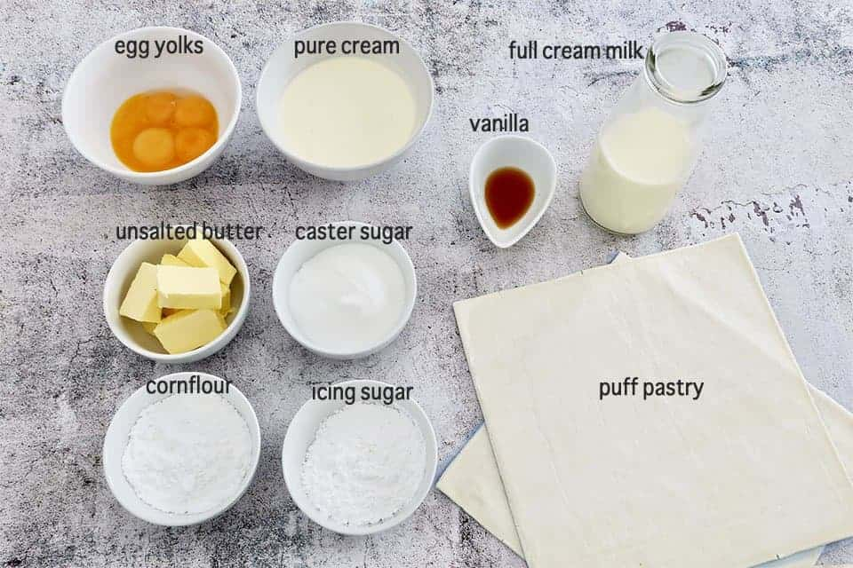 ingredients to make Mille Feuille with Berries on a concrete table
