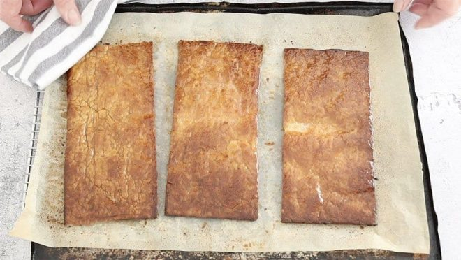 pastry sheets after glazing with icing sugar and baking to make Mille Feuille with Berries